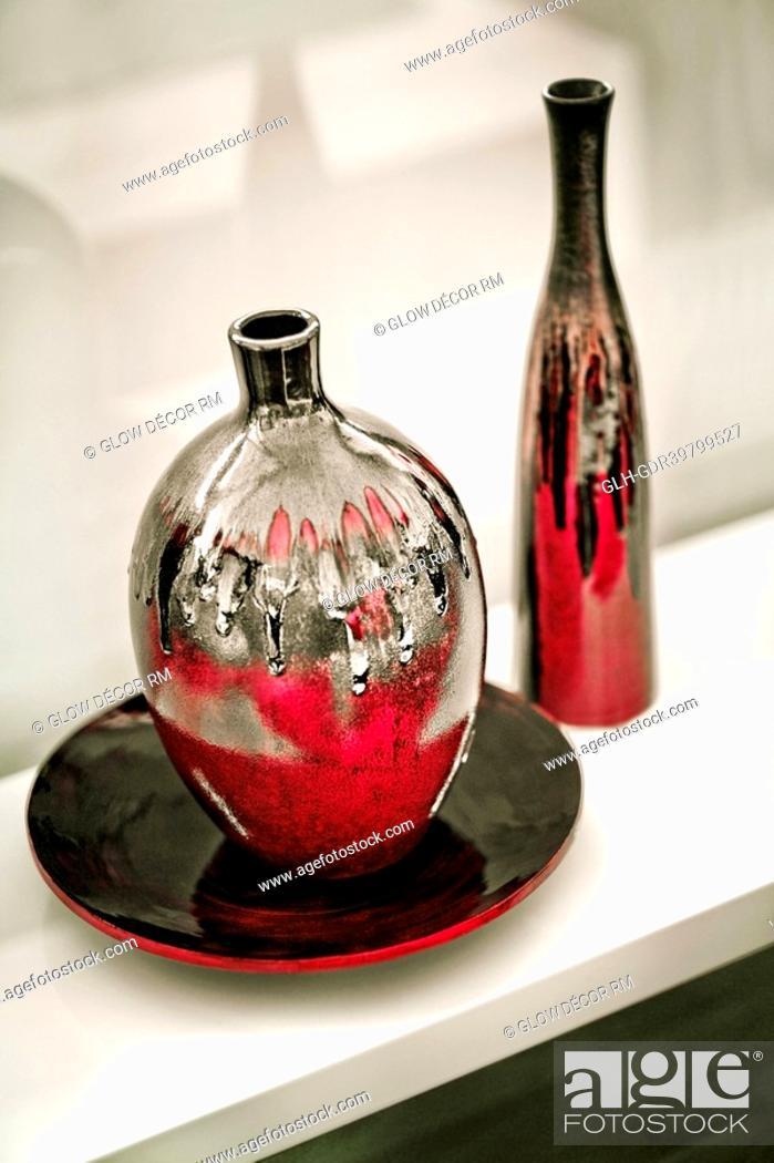 Photo de stock: Vases on a rack.