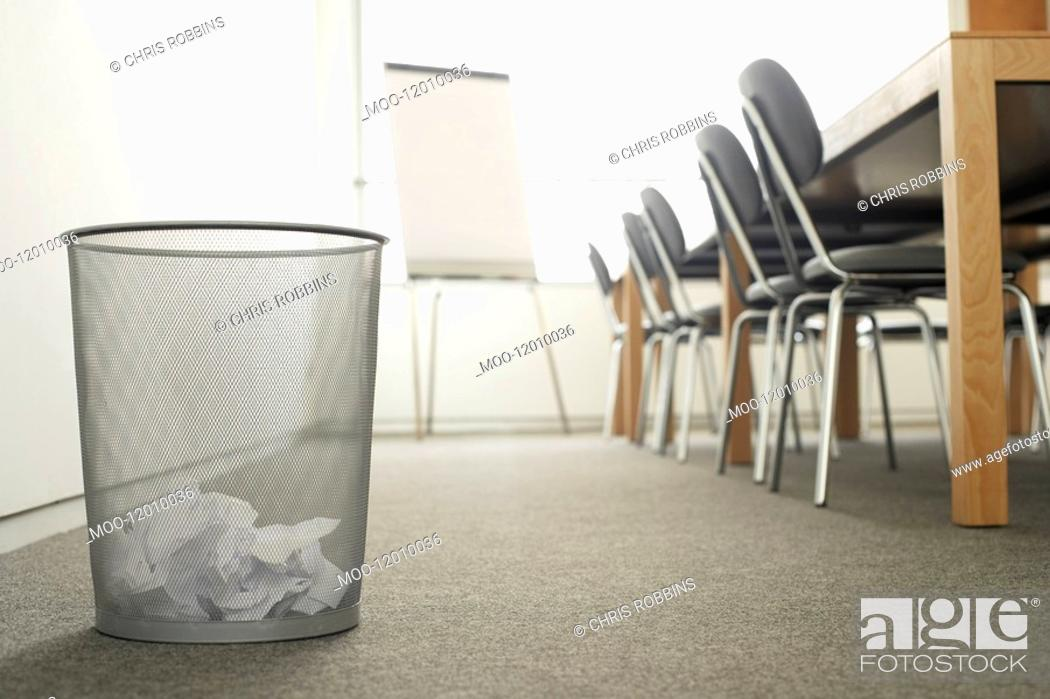 Stock Photo: Trash Can in Empty Meeting Room.