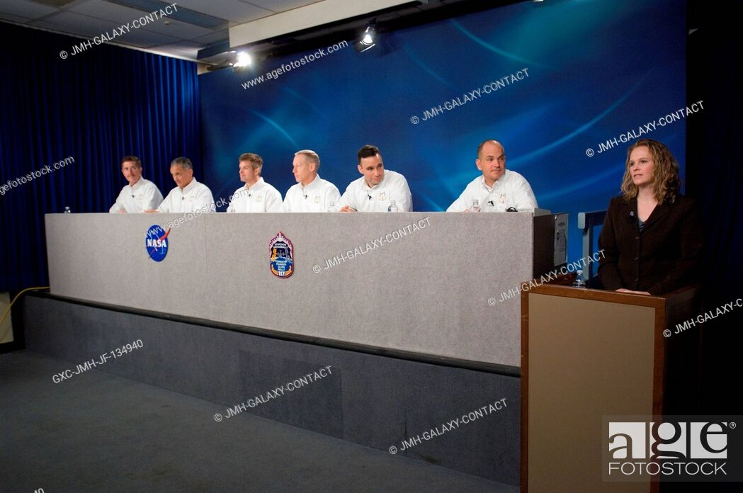 Stock Photo: The STS-117 crewmembers along with moderator Kylie Clem (right) are photographed during a pre-flight press conference at Johnson Space Center.