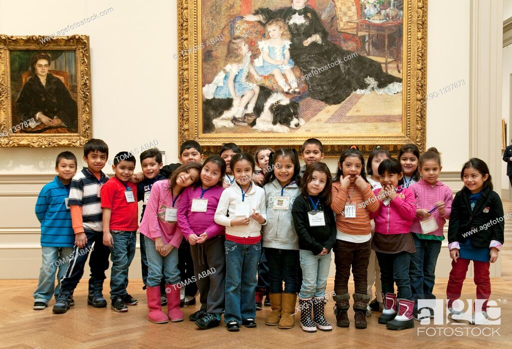 Stock Photo: Metropolitan Museum of Art, New York City, public elementary school children during a field trip posing besides an Auguste Renoir painting.