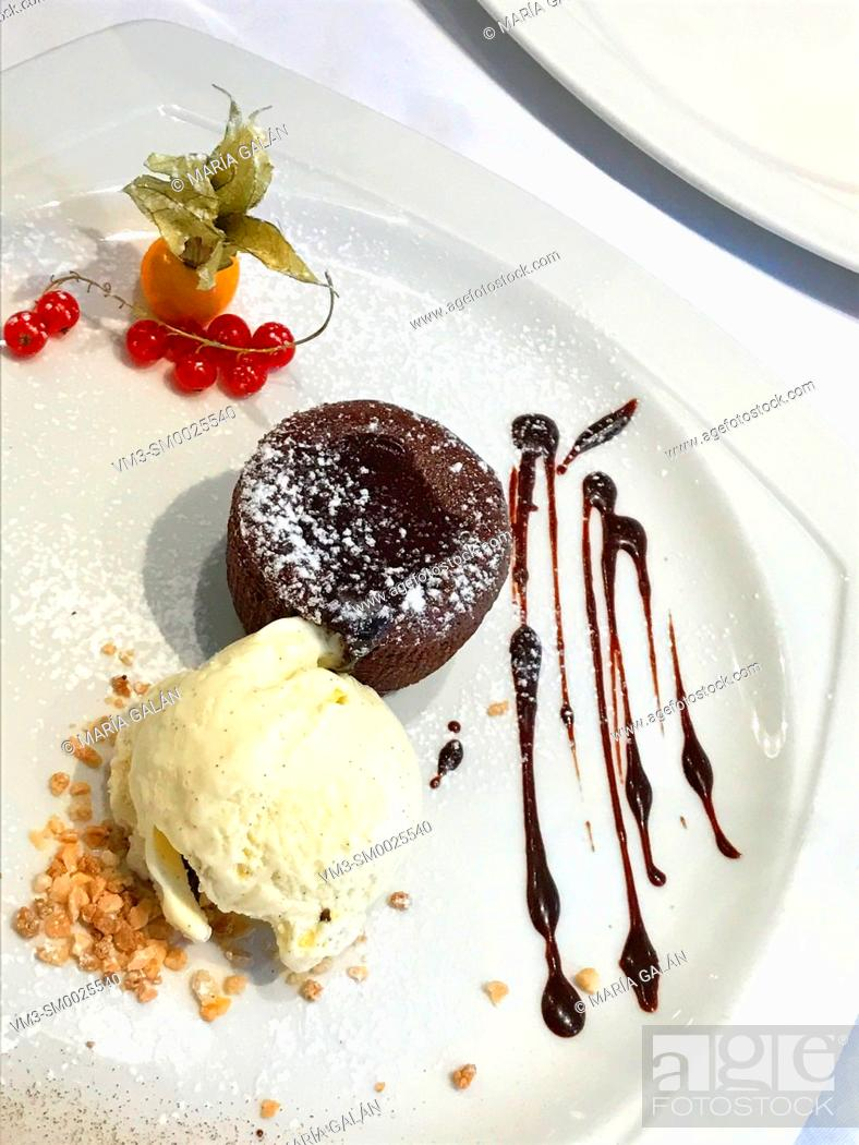 Stock Photo: Chocolate cake with ice cream.