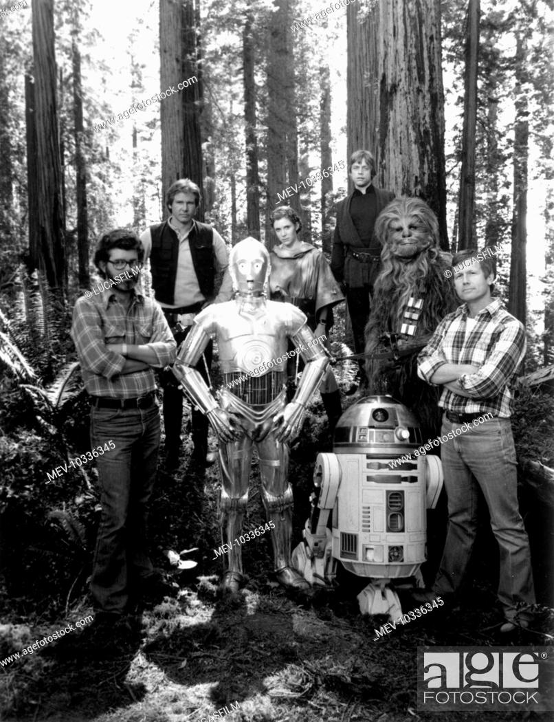 Stock Photo: STAR WARS: EPISODE VI - RETURN OF THE JEDI [US 1983] [L-R] Executive Producer GEORGE LUCAS, HARRISON FORD, ANTHONY DANIELS as 'C-3P0', CARRIE FISHER.