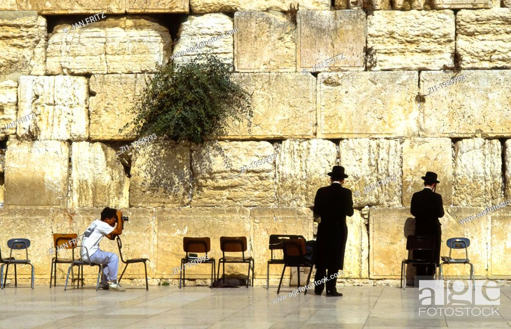 Photo de stock: Two praying jews at the Wall at Jerusalem being photographed.
