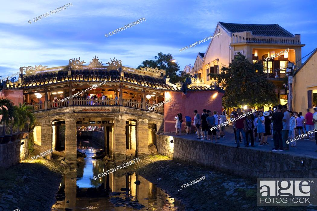 Stock Photo: Japanese covered bridge at dusk, Hoi An, UNESCO World Heritage Site, Quang Nam Province, Vietnam, Asia. . hoi an; quang nam; vietnam; asia; color image; color;.