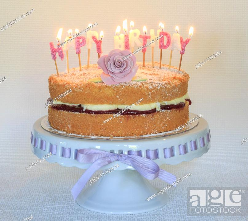 Stock Photo: Birthday cake - with candles burning.
