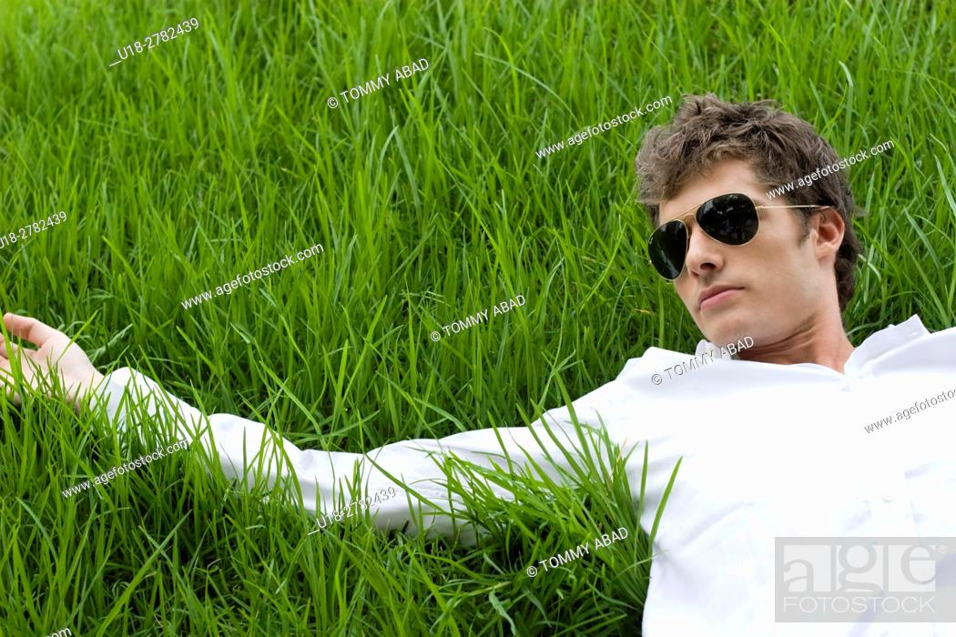 Stock Photo: man laying down on the grass.