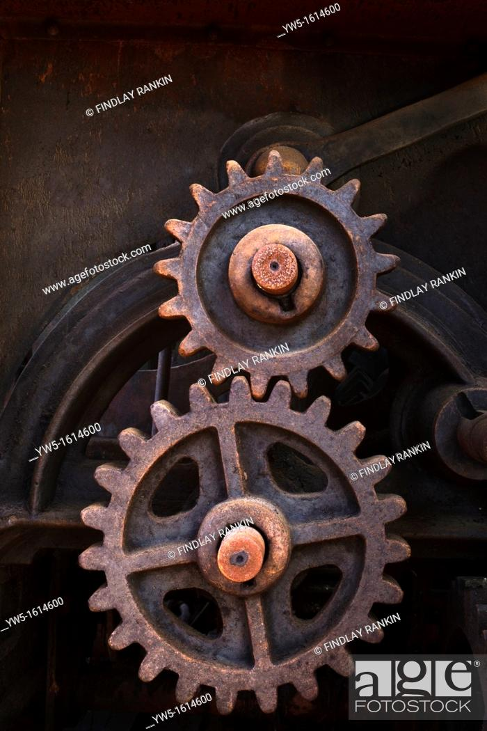 Stock Photo: Rusty cogs in an old piece of machinery.