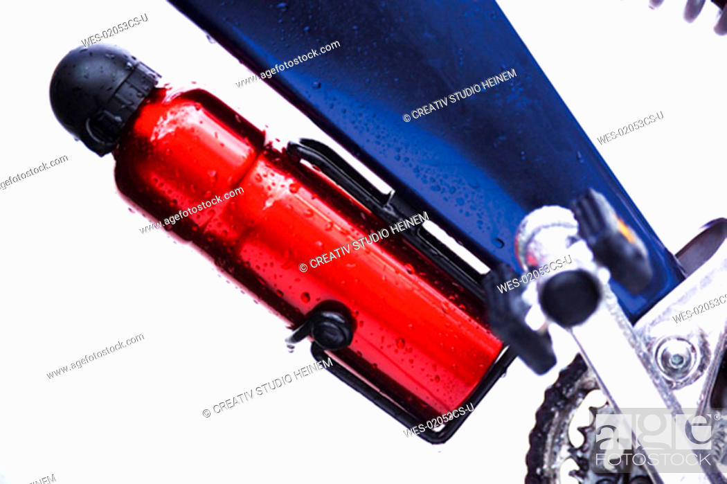 Stock Photo: Water bottle attached to mountain bike, close-up.