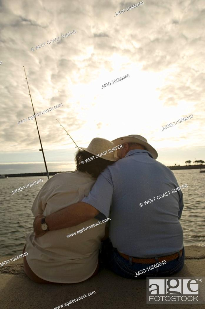 Stock Photo: Senior couple fishing at ocean.