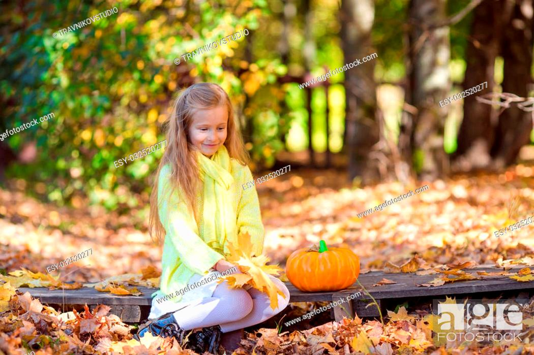 Stock Photo: Adorable little girl at beautiful autumn day outdoors.