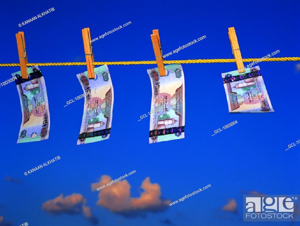Stock Photo: United Arab Emirates banknotes hanging on a clothesline.