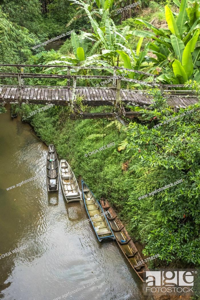 Stock Photo: An old wooden bridge at Kampung Bengoh, Sarawak, East Malaysia.