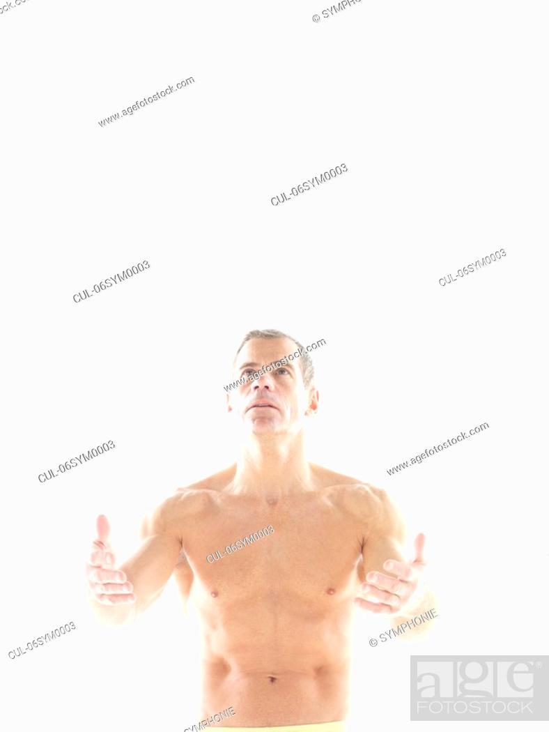 Stock Photo: Mature man breathing exercises.