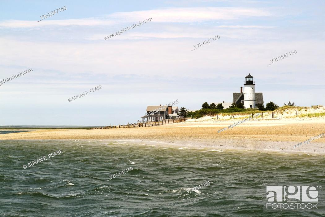 Stock Photo: Sandy Neck Beach's old cottage colony and Sandy Neck Lighthouse seen from Barnstable Harbor, Cape Cod, Massachusetts, United States, North America.