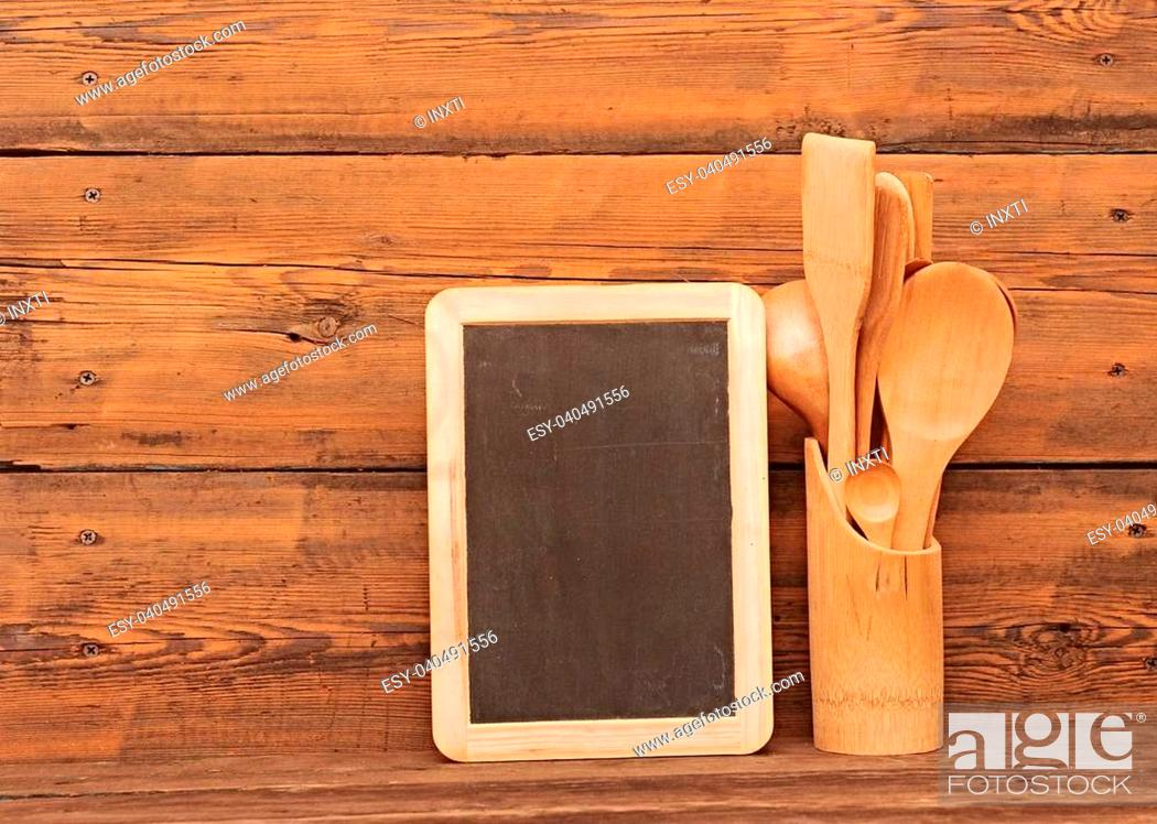 Stock Photo: blank blackboard on wooden surface and wooden utensils.