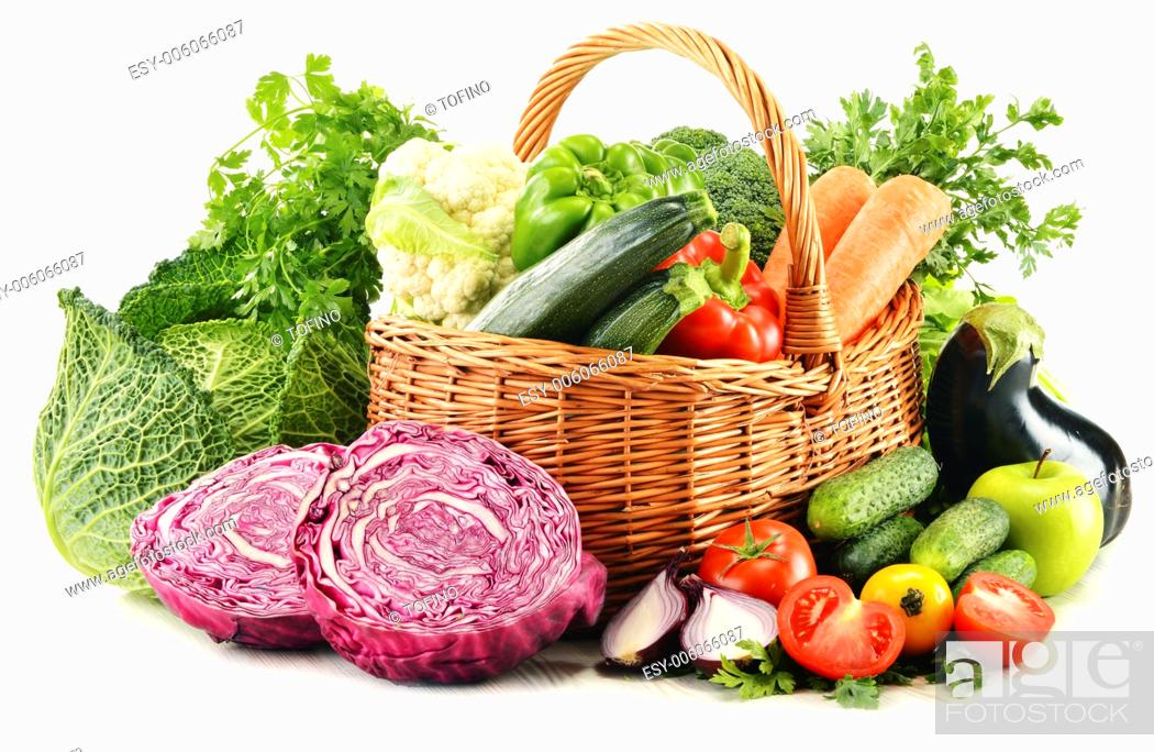 Stock Photo: Composition with variety of fresh organic vegetables isolated on white.