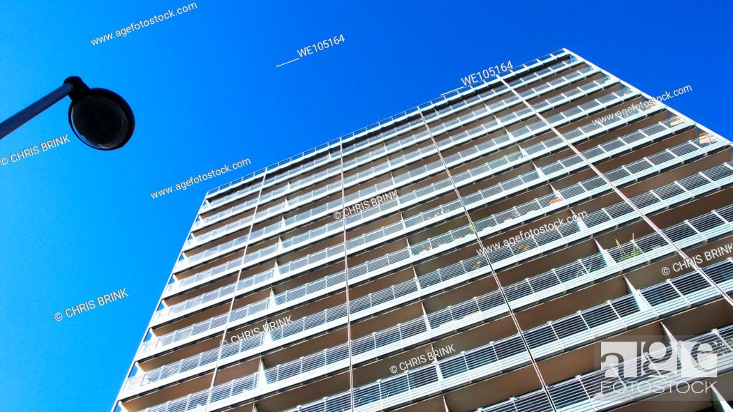 Stock Photo: Modern apartments with balconies and streetlight in Manchester, UK.