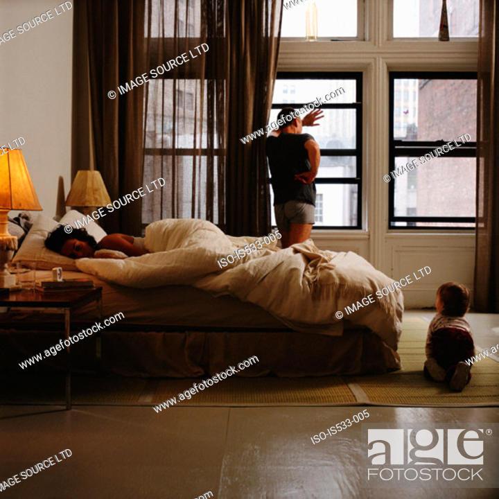 Stock Photo: Family in bedroom.