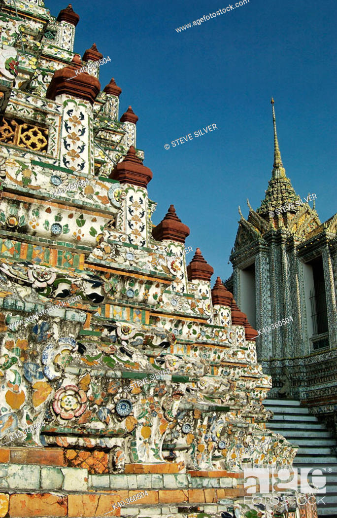 Stock Photo: Close up on the tower plated with mosaic of porcelain pieces. Wat Arun temple (Temple of the Dawn). Bangkok. Thailand.