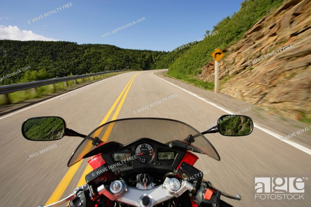 Stock Photo: View on Motorcycle in action on Cabot Trail, Cape Breton Highlands National Park, Nova Scotia, Canada.