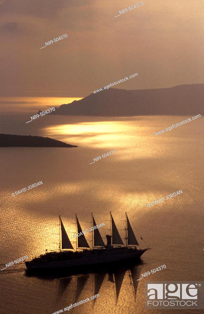 Stock Photo: Golden Sunset on the Caldera. Fira. Santorini Island. Greece.