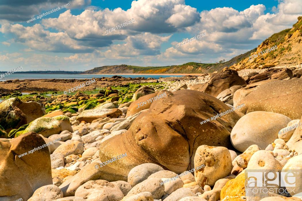 Stock Photo: Stones and clouds at Osmington Bay, Osmington Mills, near Weymouth, Jurassic Coast, Dorset, UK.