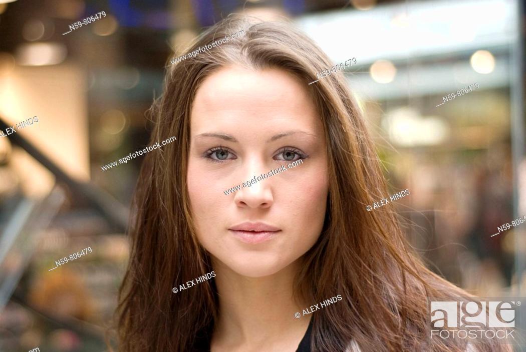 Stock Photo: Beautiful brunette woman in urban setting.