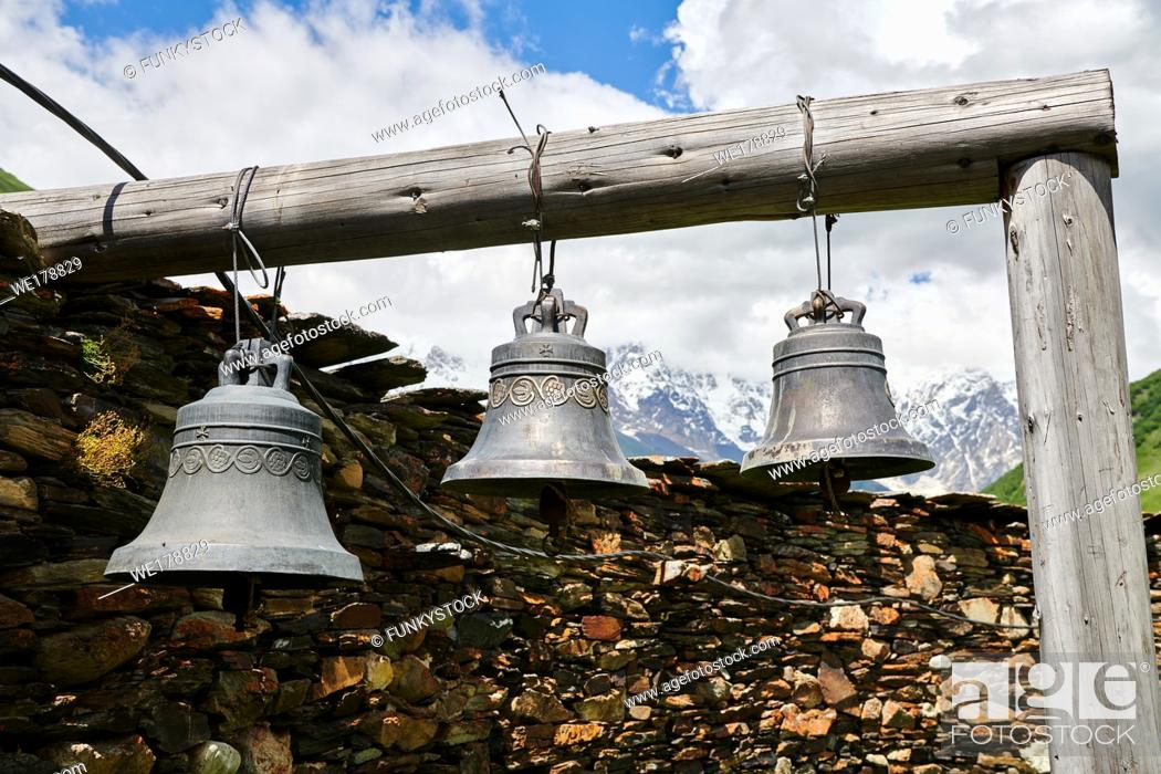 "Stock Photo: Bells of the medieval Georgian Orthodox St George Church ""JGRag"" with mount Shkhara (5193m) behind, Ushguli, Upper Svaneti, Samegrelo-Zemo Svaneti, Mestia."
