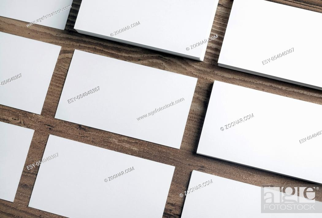 Stock Photo: Blank white business cards on wooden background. Mockup for branding identity. Template for graphic designers portfolios.