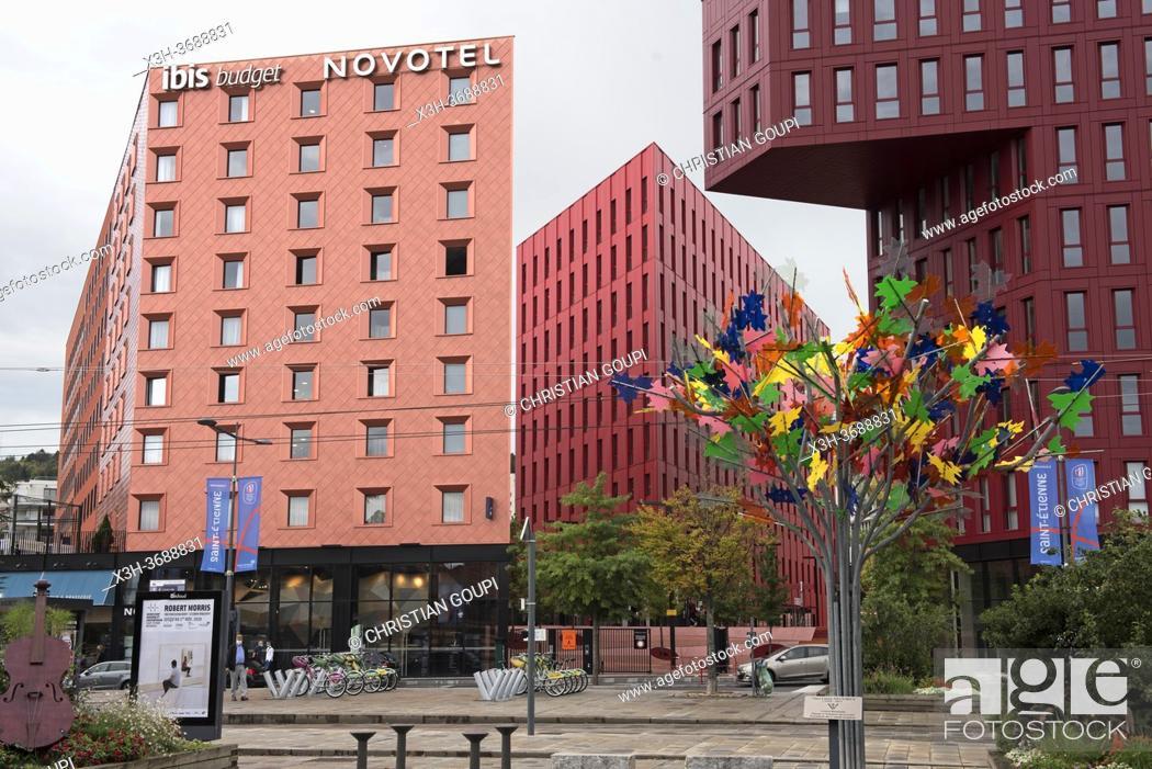 Stock Photo: Arbre multicolore de l'artiste Philippe Million sur le parvis de la gare face a l'Ilot Poste-Weiss (Architectes: ECDM), quartier Chateaucreux, Saint-Etienne.
