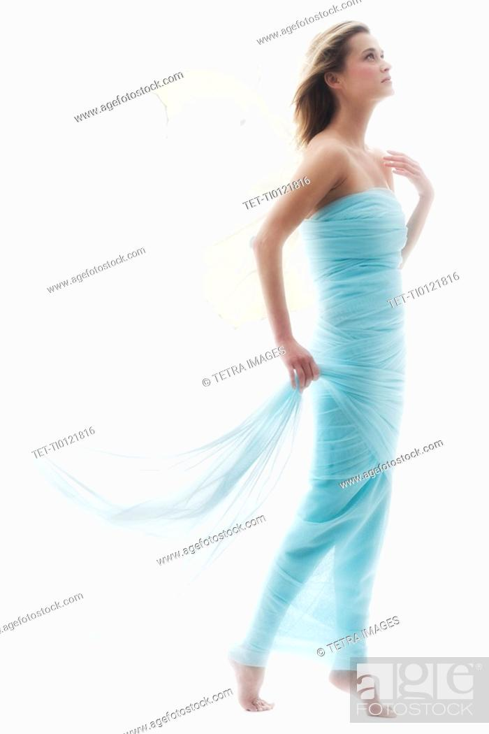 Stock Photo: Young woman in full length gown.