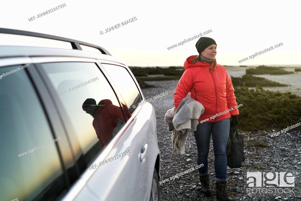 Stock Photo: Woman at sea near car.