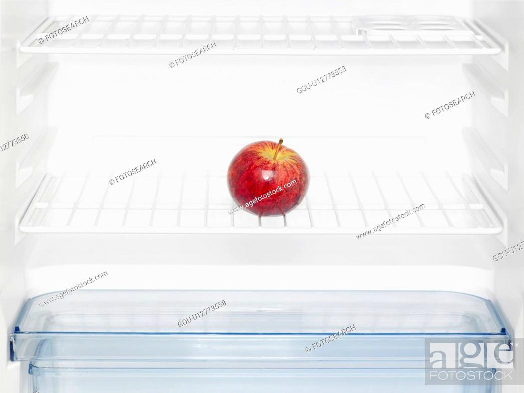 Stock Photo: Red apple in fridge (close-up).