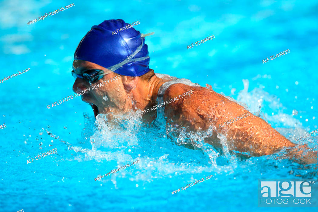 Stock Photo: Male Swimmer Swimming Butterfly.