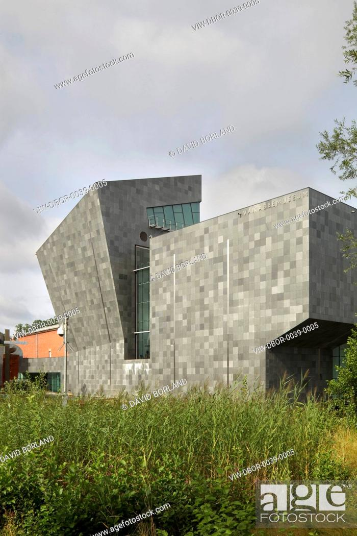 Stock Photo: Van Abbemuseum, Eindhoven, Netherlands. Architect: Abel Cahen, 2003. Exterior view against cloudy sky.