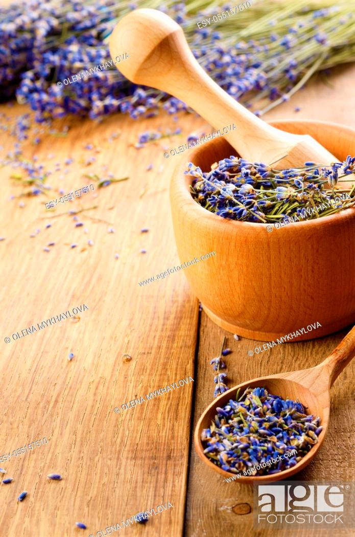 Stock Photo: Pestle and mortar with lavender flowers with copy-space.