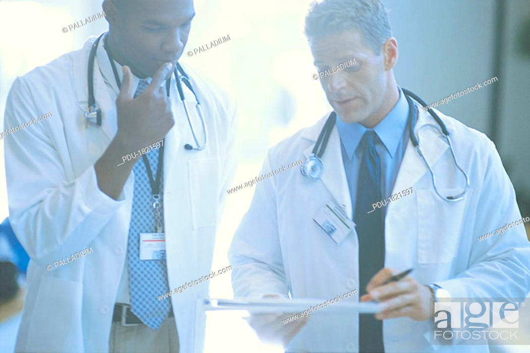 Stock Photo: Medical professionals in discussion.