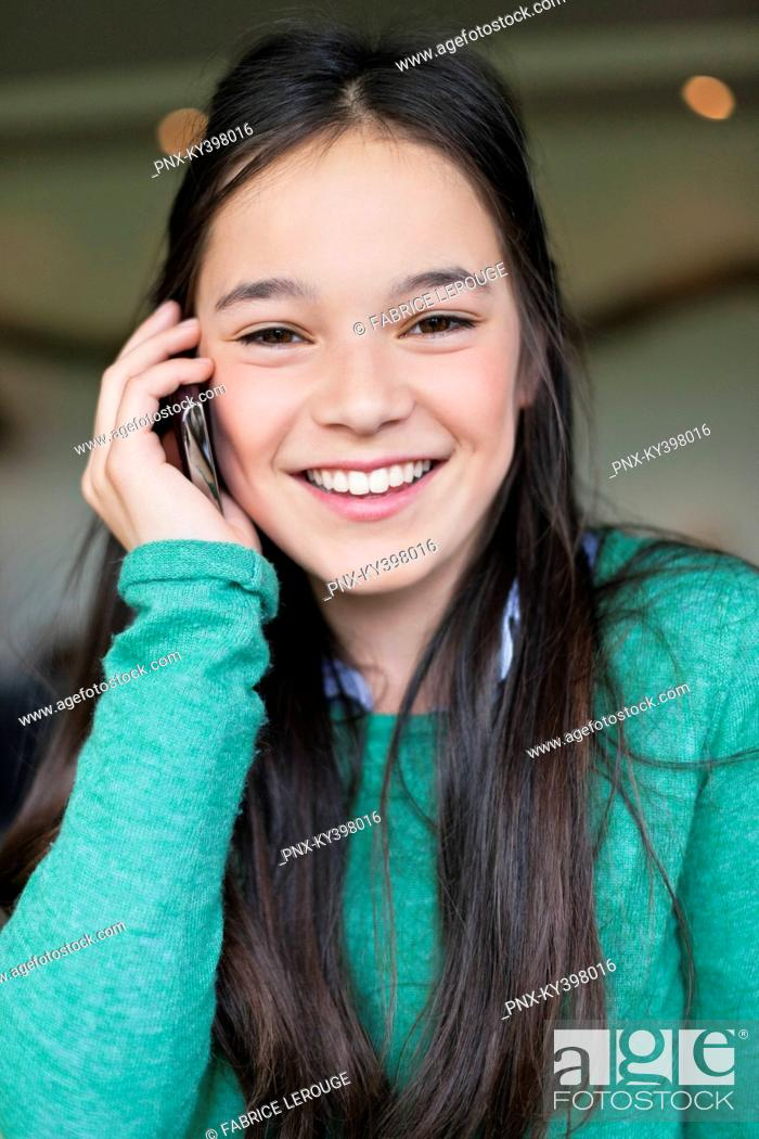 Stock Photo: Girl talking on a mobile phone.