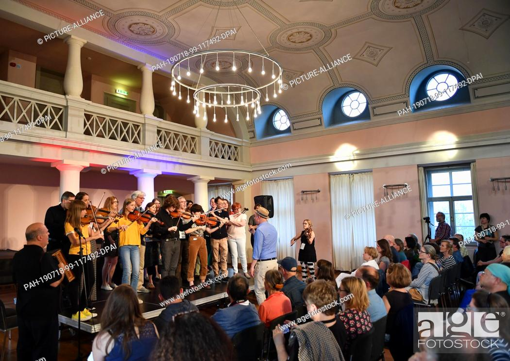 """Stock Photo: 18 July 2019, Thuringia, Weimar: Participants and lecturers of the workshop """"""""Yiddish Instrumental Music"""""""" will give their final concert at the Musikschule."""