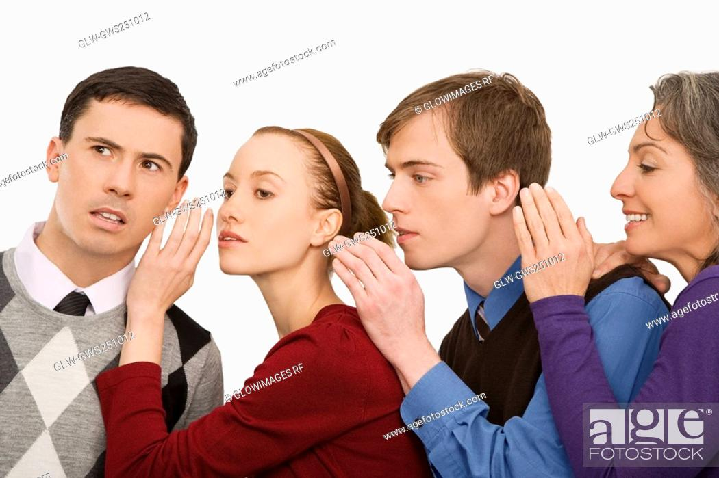 Stock Photo: Business executives whispering to each other.