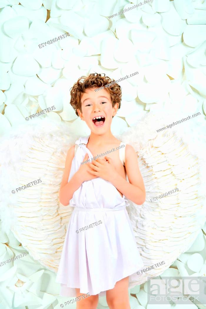 Stock Photo: Portrait of a lovely emotional little boy in a costume of angel. Cupid. Valentine's day.