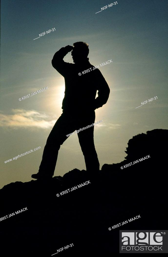 Stock Photo: Silhouette of a person looking into the distance.