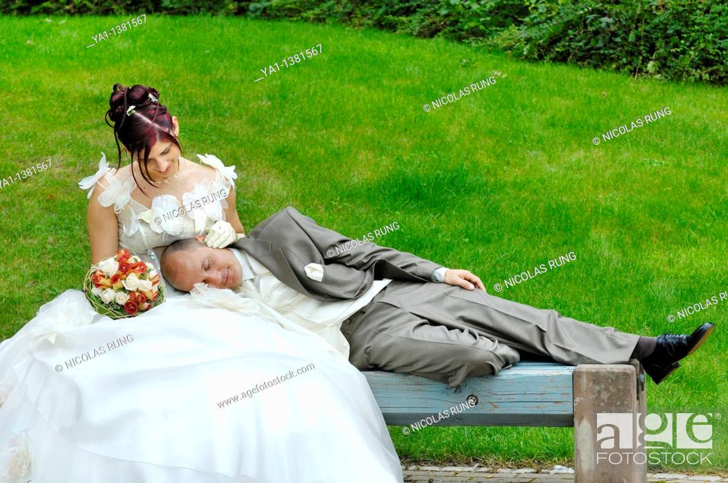 Stock Photo: Newlywed couple with husband asleep on his wife in bench's park, Sarreguemines, Moselle, Lorraine, France.