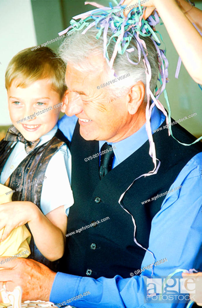 Stock Photo: Close-up of a grandfather smiling at grandson.