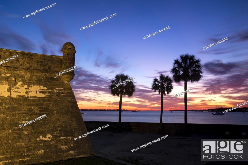 Stock Photo: Sunrise over Matanzas Inlet and Castillo de San Marcos, St. Augustine, Florida.