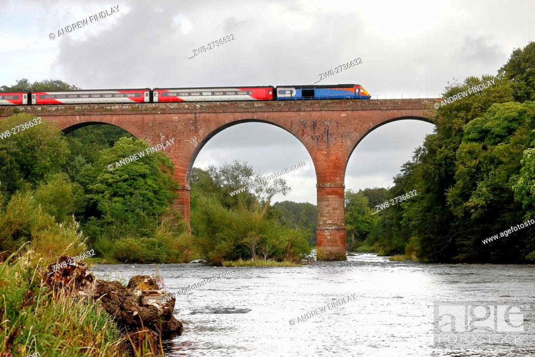 Stock Photo: East Midlands Trains InterCity 125 crossing Wetheral Viaduct over the River Eden. Wetheral, Newcastle & Carlisle Railway, Cumbria, England, United Kingdom.