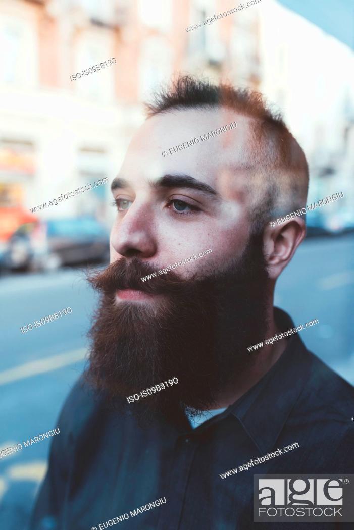 Stock Photo: Portrait of bearded man looking away.