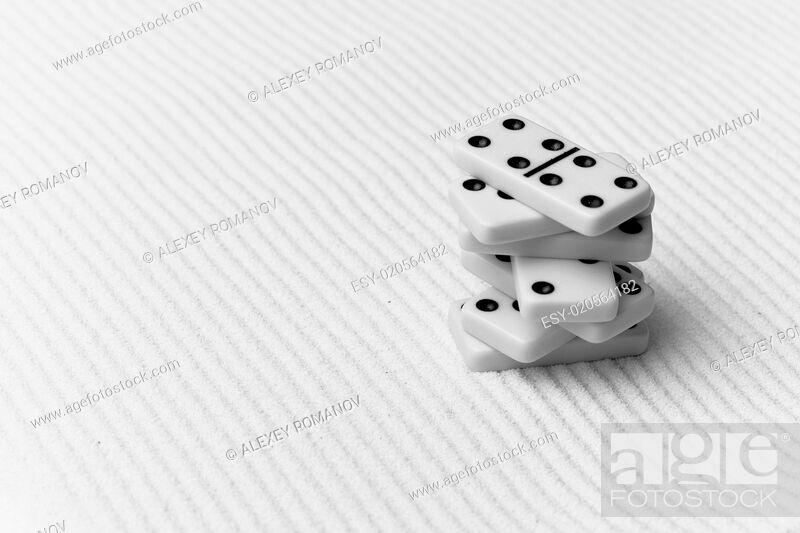 Imagen: Dominoes against sand.