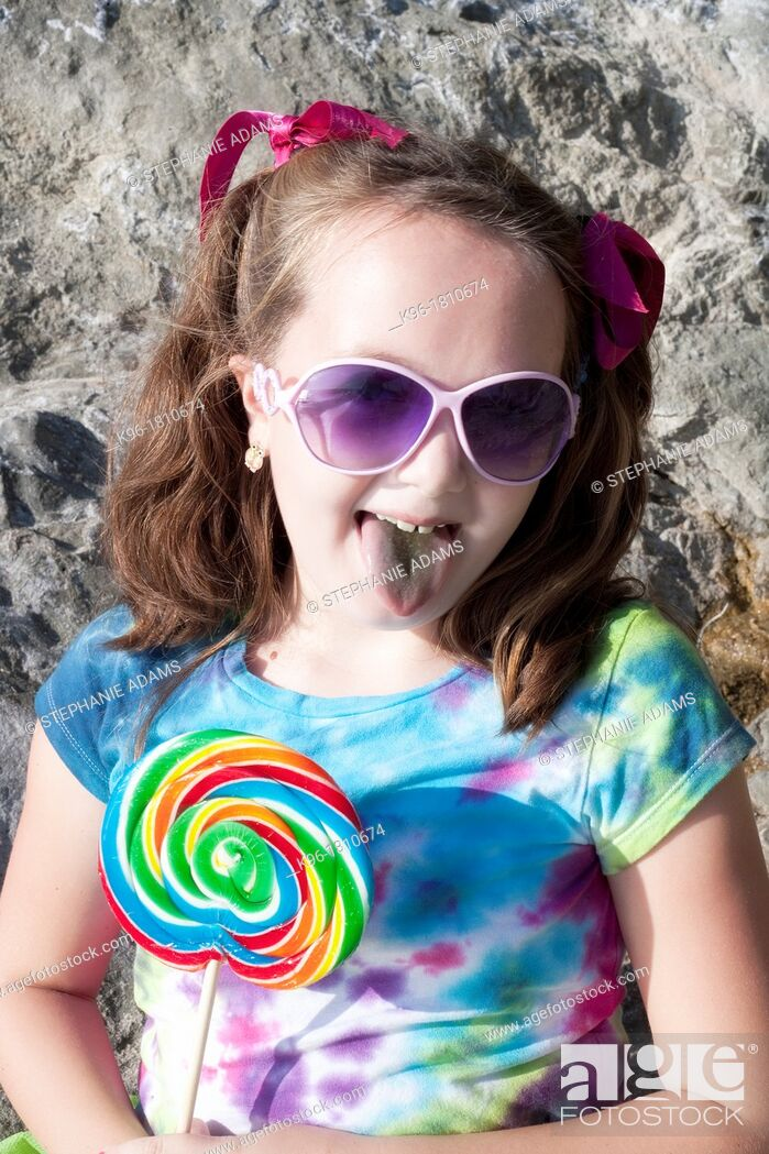 Stock Photo: little girl sticking out tongue.