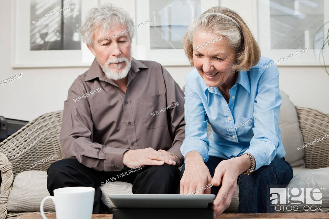 Stock Photo: Senior couple with digital camera.